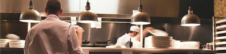 restaurant kitchen where people are preparing food
