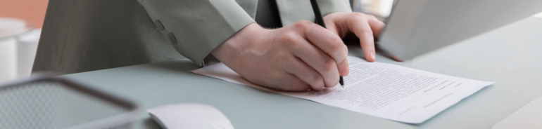 person writing on document
